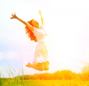 Happiness is often symbolized by depicting people with arms spread out, people jumping and people looking into the sun.