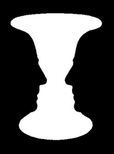 Rubin's vase: A classical example of figure/ground segmentation. The image is fundamentally ambiguous. People perceive a vase or faces, but not both at the same time.